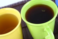 Color mug (with tea and coffee Stock Photography