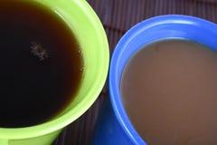 Color mug (with tea and coffee Stock Image