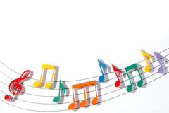 Color Musical Notes. Color Wooden Musical Notes With Shadows Over Glass Royalty Free Stock Images
