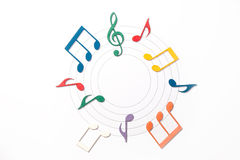 Color Musical Notes. Color Wooden Musical Notes With Shadows Over Music Sheet In Circle royalty free stock image