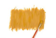 Color of mustard hand-painted daub with paint brush. Color of mustard gouache hand-painted daub with used paint brush Royalty Free Stock Photos