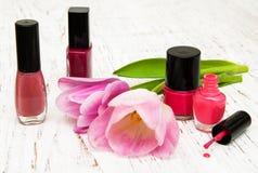 Color nail polish and tulips Stock Image
