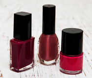Color nail polish. On a wooden background Royalty Free Stock Photo