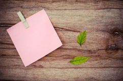 Color note, blank paper, post it. Blank paper on wood borad stock image