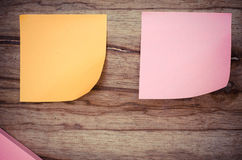 Color note, blank paper, post it. Blank paper on wood borad Stock Photo