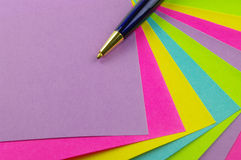 Color notes with blue pen. Bright color notes with a blue and gold pen Stock Photography