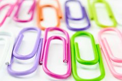 Color office clips. Office background royalty free stock images