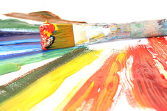 Color oil paint and brush Royalty Free Stock Images