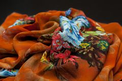Color orange textil, silk fabric with pleats Royalty Free Stock Photography
