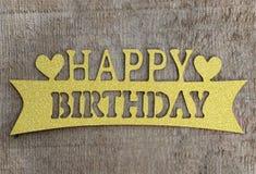 Color oro de madera de la tarjeta del feliz cumpleaños Fotografía de archivo libre de regalías