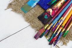Color paint brushes in white background Stock Image