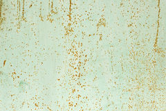 Color paint flaking and cracking texture. Rusty green painted texture. Stock Image