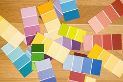 Color paint swatches. Paint color swatches spread out on wood floor Royalty Free Stock Photo