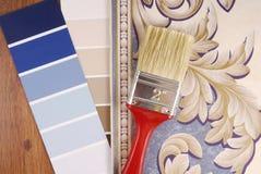 Color paint and wallpaper choice. Closeup of the color paint and wallpaper choice Royalty Free Stock Photos