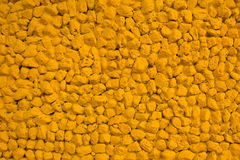 Color paint yellow stone wall for background Royalty Free Stock Images