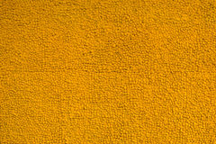 Color paint yellow stone wall for background Stock Photography