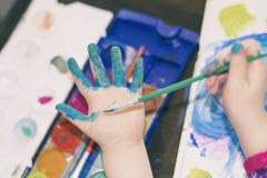 Color painted child hand Stock Photos