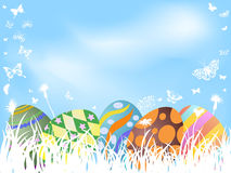 Color painted easter eggs background. The background of color painted easter eggs hiding in grass Stock Images