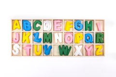 Color painted wooden english alphabet set in wooden box Royalty Free Stock Photos