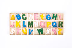 Color painted wooden english alphabet set in wooden box Royalty Free Stock Images