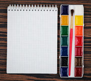 Color paints and notebook Stock Photography