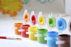 Color Paints and Paint Brush. Close-up of different colored paints, paint brush and a painting Stock Photography