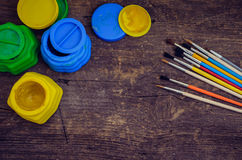 Color paints with paint brushes Royalty Free Stock Images