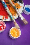 Color palette. With two bristle-paint royalty free stock photo