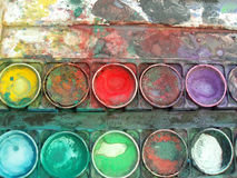 Color palette box. Close-up of multicolored well used color palette box royalty free stock photography