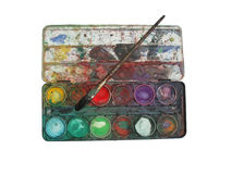 Color palette box. Isolation of multicolored well used color palette box with brush royalty free stock image