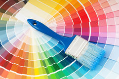 Color palette and brush. With blue handle royalty free stock photography