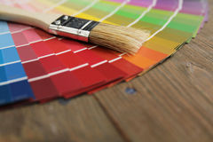 Color palette and brush. Different color palette and brush on a wooden surface Royalty Free Stock Image