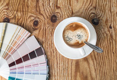 Color palette and coffee cup royalty free stock photos