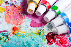 Color palette with different color tubes. Colorful color mixing palette of different color tubes Stock Images