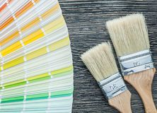 Color palette fan paintbrushes on wooden board Stock Photography