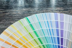 Color palette fan on wooden board Royalty Free Stock Image