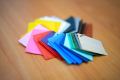 Color palette guide on wooden board close up view. Top view Stock Photo