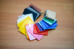 Color palette guide on wooden board close up view. Top view Stock Photos
