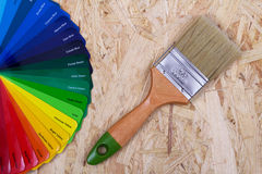 Color palette of paint and a brush Stock Photo