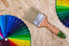 Color palette of paint and a brush royalty free stock photos