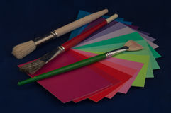 Color Palette. Paint brushes on top of color swatches resembling an artists color palette Stock Photography