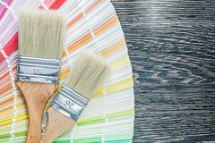 Color palette paint brushes on wooden board Stock Image