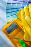 Color palette paint roller tray protective gloves on white surfa. Ce royalty free stock photo