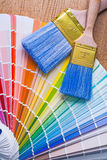 Color palette and paintbrushes on wooden board Royalty Free Stock Images
