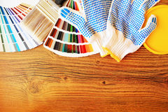 Color palette and painting tools. On wooden background royalty free stock image