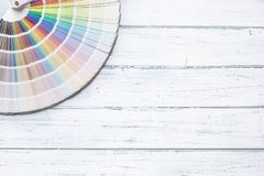 Color palette for painting on a wooden table - top of view.  stock photos