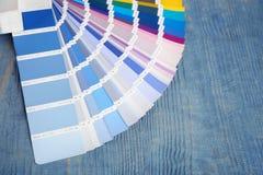 Color palette samples on background. Color palette samples on wooden background royalty free stock photo