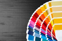 Color palette samples on black background. Closeup royalty free stock photo