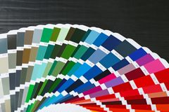 Color palette samples on black background. Closeup royalty free stock images