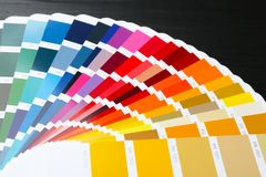 Color palette samples on black background,. Closeup Stock Images